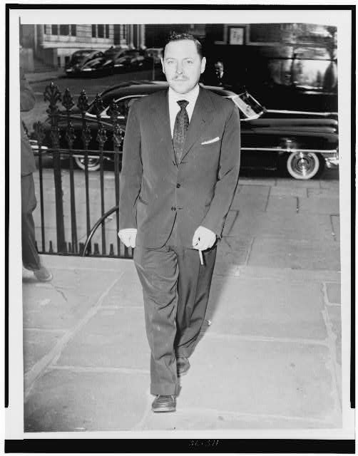 [Tennessee Williams, full-length portrait, walking, at service for Dylan Thomas, facing front]