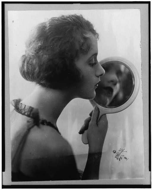 [Constance Talmadge, head-and-shoulders portrait, facing right, looking into mirror]