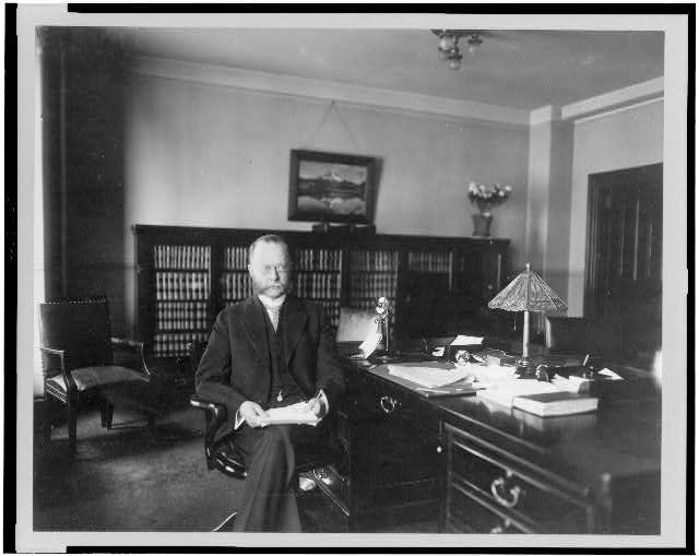 [William C. Redfield, three-quarter length portrait, facing front, seated in office]