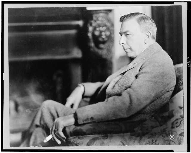 [Booth Tarkington, three-quarter length portrait, seated, facing left]