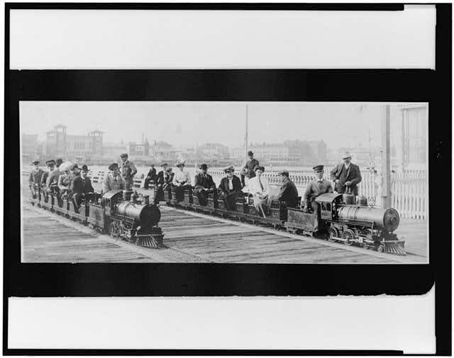 [People on two miniature railroad trains on bridge or pier, possibly at Dreamland, Coney Island, New York City]