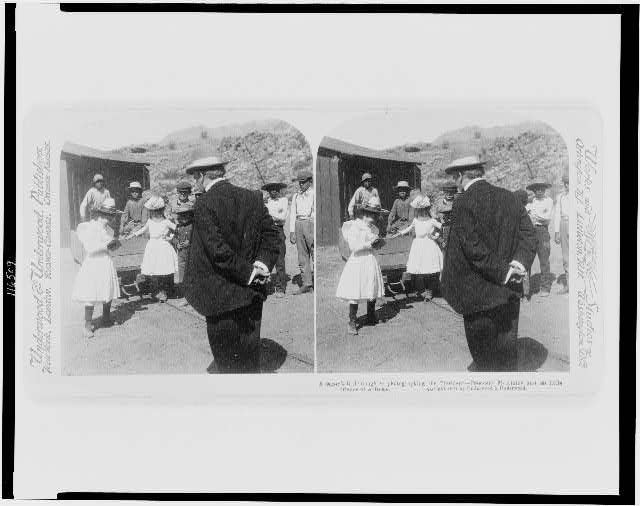 A miner's daughter photographing the President--President McKinley and his little friends of Arizona
