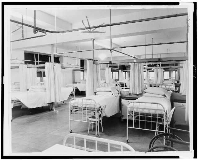 [Interior view showing empty beds of tuberculosis ward]