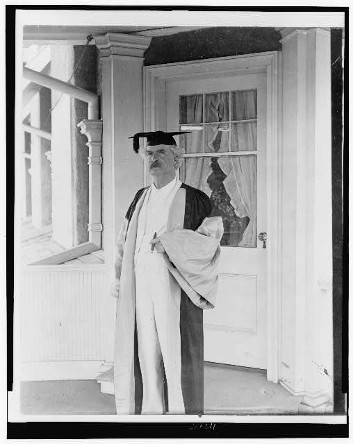 [Samuel Langhorne Clemens, (Mark Twain), full-length portrait, standing, facing left, in academic cap and gown]