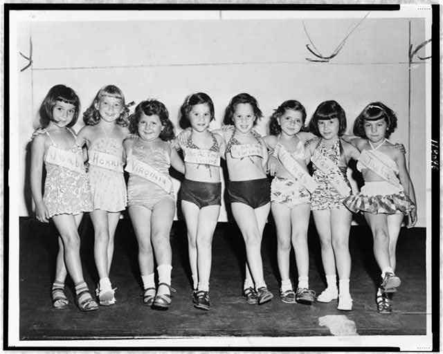 Girls line up for beauty contest at the playground/World ...
