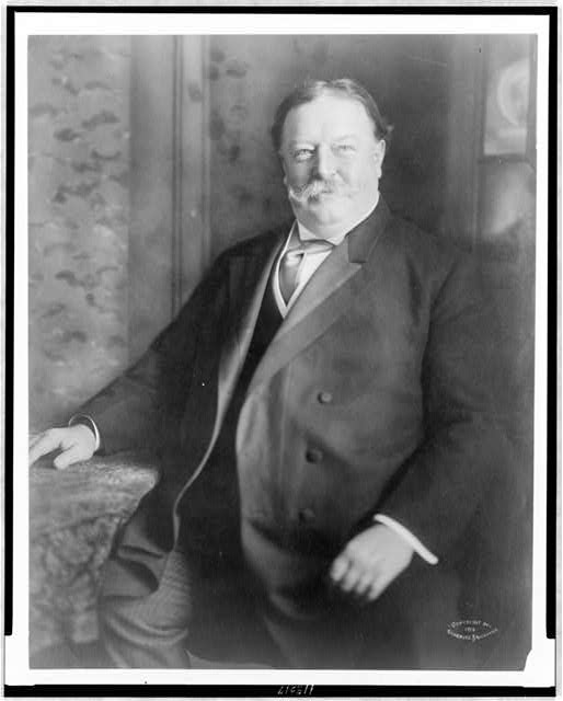 [William Howard Taft, three-quarter length portrait, seated, facing front]