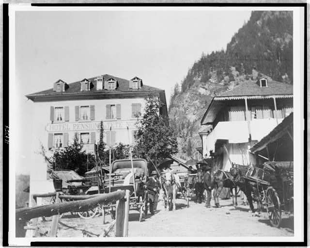 [Hotel Pension la Tete Noire, somewhere in Europe, with horses and carriages in foreground]