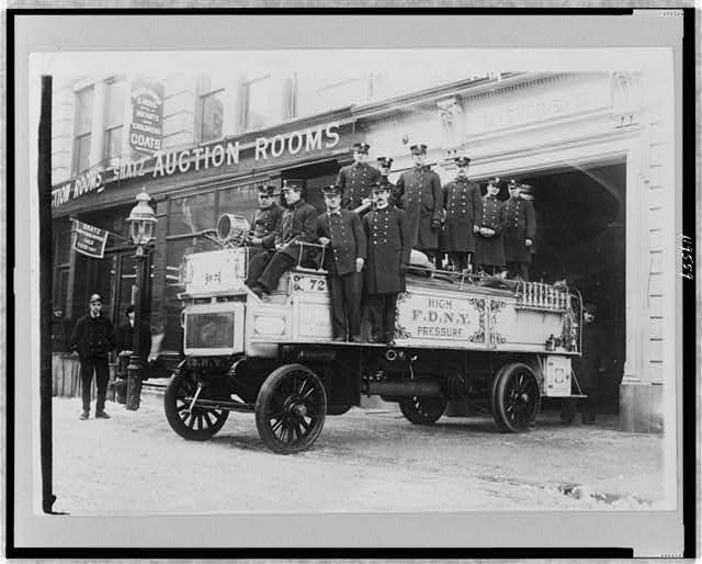[Firemen posed on fire engine, New York City]