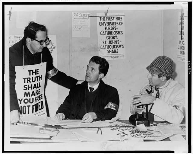 [Three St. John's University teachers conferring at strike headquarters: (left to right) Ken Lazara (physics instructor), Dr. Carlo Prisco (Associate professor of modern languages), and Joseph V. Phillips (associate professor of fine arts and strike chairman)]