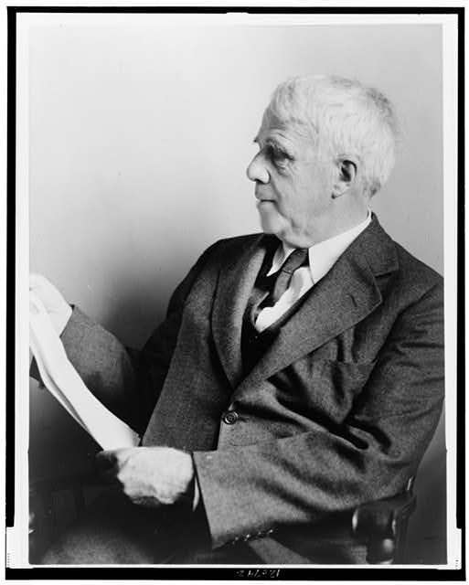[Robert Frost, half-length portrait, seated, facing left]