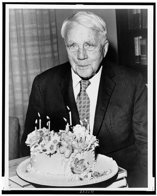 [Robert Frost, poet poses with his birthday cake on his 85th birthday]