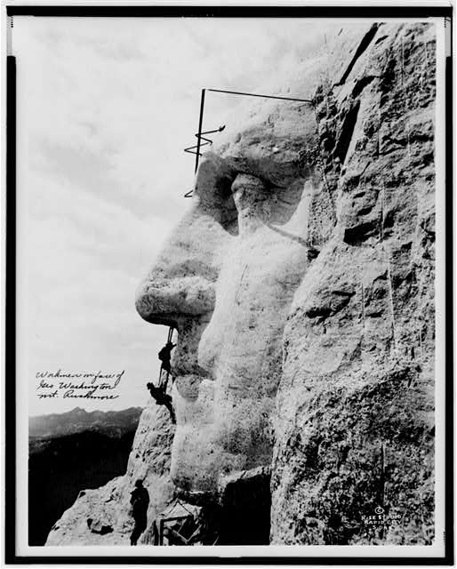 Workmen on face of Geo. Washington, Mt. Rushmore