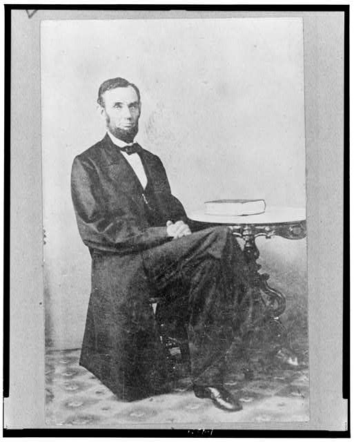 [Abraham Lincoln, full-length portrait, seated, facing slightly right]