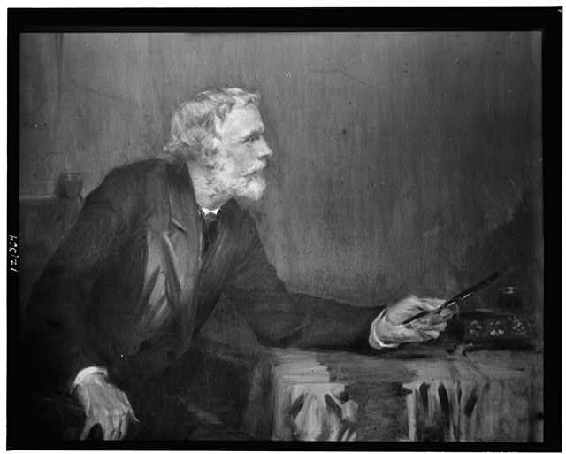 [George Meredith, sitting in chair, three-quarter-length portrait]