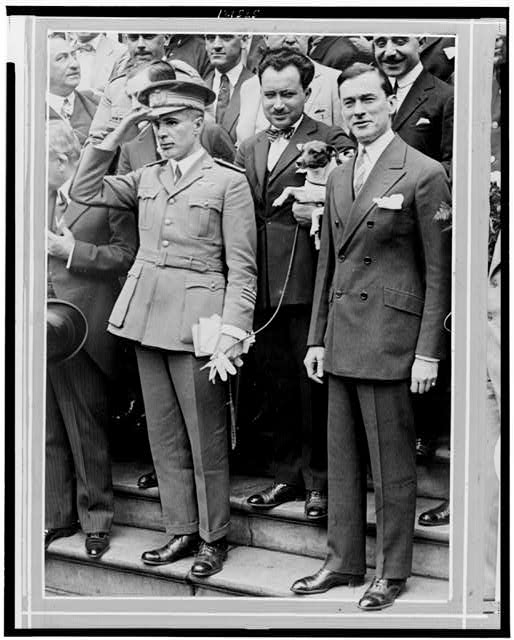 Major Gen. Umberto Nobile greeted at City Hall by Mayor Walker (right) - they are standing at attention as the Star Spangled Banner is played