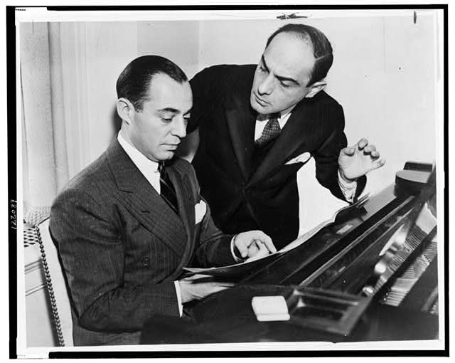 [Richard Rodgers seated at piano with Lorenz Hart on right]