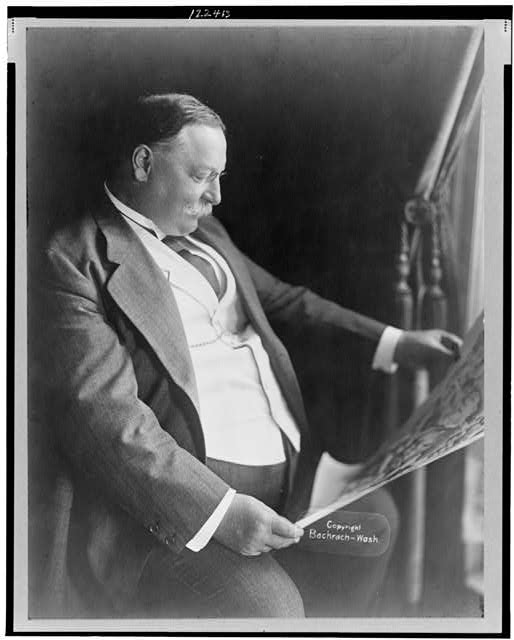 [William Howard Taft, three-quarter length portrait, seated, facing right]