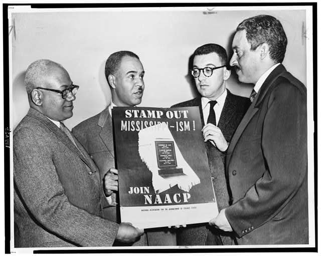 Holding a poster against racial bias in Mississippi are four of the most active leaders in the NAACP movement, from left: Henry L. Moon, director of public relations; Roy Wilkins, executive secretary; Herbert Hill, labor secretary, and Thurgood Marshall, special counsel