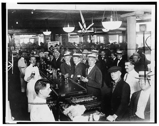 [Interior of a crowded bar moments before midnight, June 30, 1919, when wartime prohibition went into effect New York City]