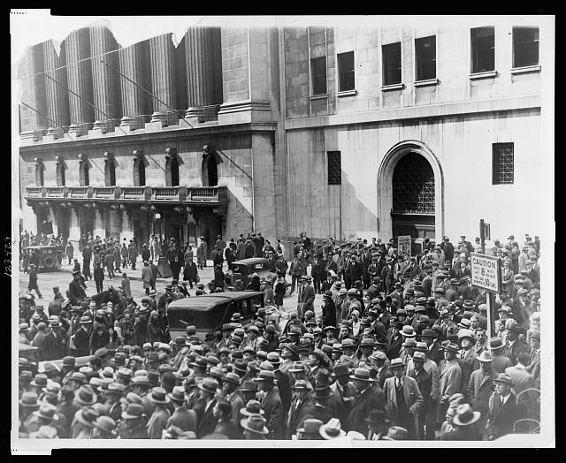 [Crowd of people gather outside the New York Stock Exchange following the Crash of 1929]