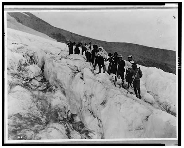 [Group of men and women mountaineering on Mount Shasta, California]