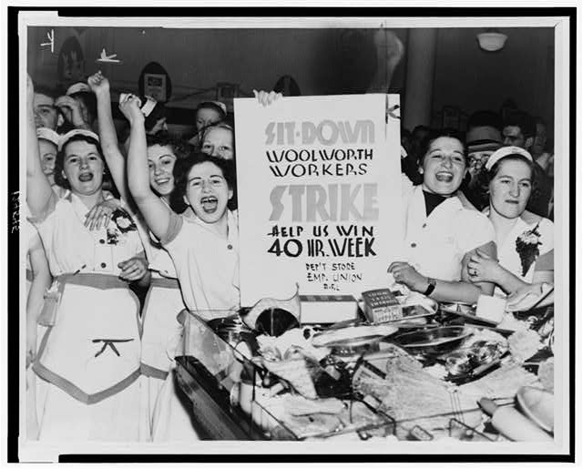 [Female employees of Woolworth's holding sign indicating they are striking for a 40 hour work week]