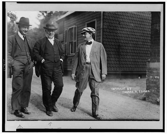 Mr. Thomas Edison walking in laboratory yard with Messrs. Miller Reese Hutchinson and Miller