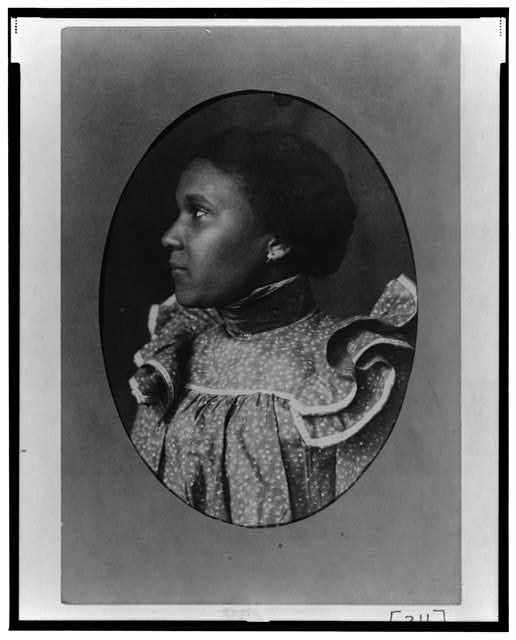 [African American woman, head-and-shoulders portrait, left profile]