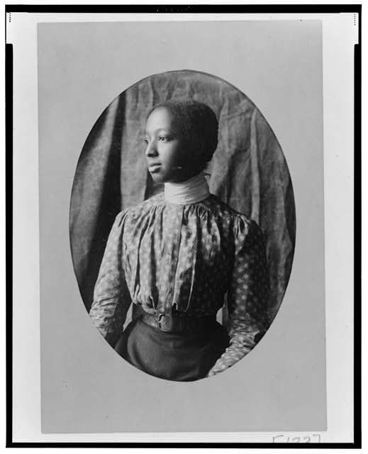 [African American woman, half-length portrait, facing left]