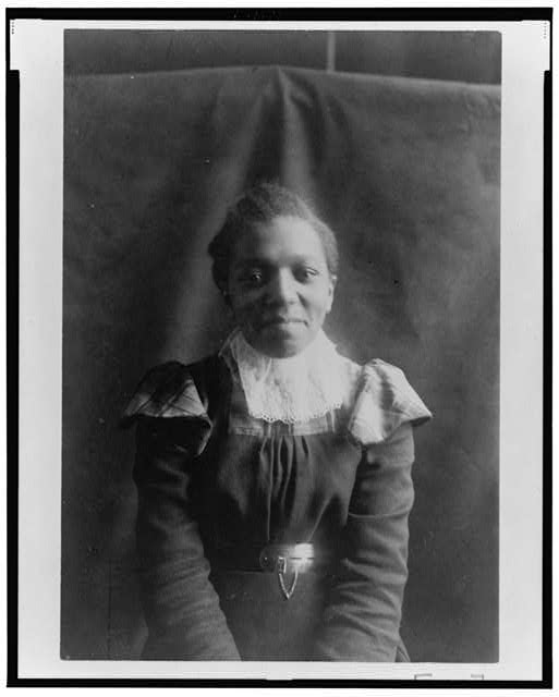 [African American woman, half-length portrait, seated, facing front]