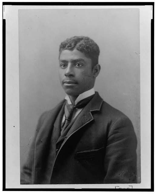 [African American man, head-and-shoulders length portrait, facing left]