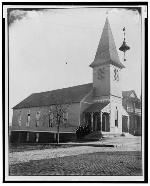 [Exterior view of church with group of African American men standing on steps in Georgia]