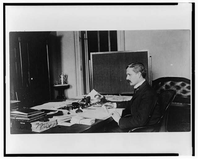 [Dr. Miller, Treasury Department employee, half-length portrait, seated at desk, facing left]