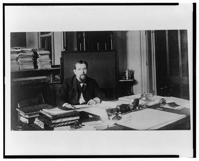[Mr. McClelland(?), Treasury Department employee, half-length portrait, seated at desk, facing front]