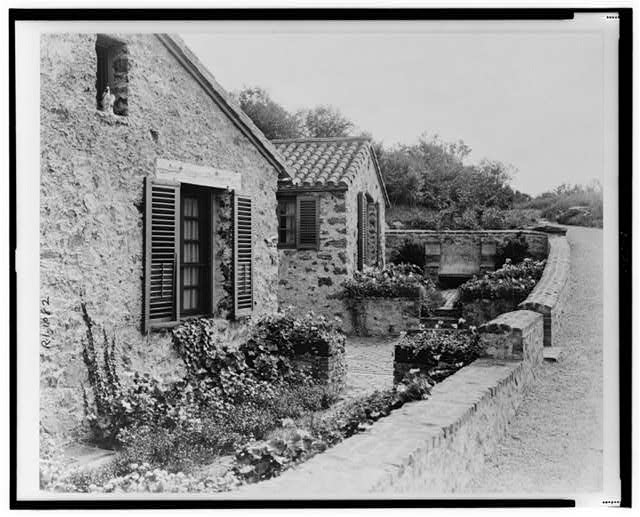 "[""Surprise Valley Farm,"" Arthur Curtiss James property, Beacon Hill Road, Newport, Rhode Island. Flower beds beside cottages]"