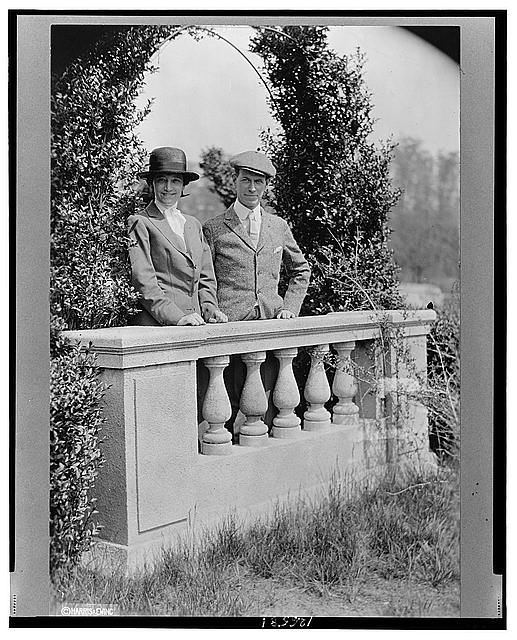 [Mr. and Mrs. Joseph Medill McCormick, half-length portrait, standing behind balustrade]