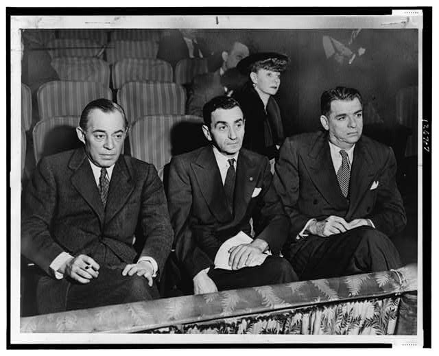 Richard Rodgers, Irving Berlin and Oscar Hammerstein II, seated in back is Helen Tamiris, they are watching hopefuls who are being auditioned on stage of the St. James Theatre [...]