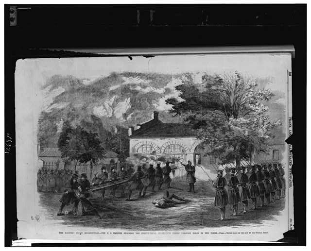 The Harper's Ferry insurrection--The U.S. Marines storming the engine house--Insurgents firing through holes in the doors