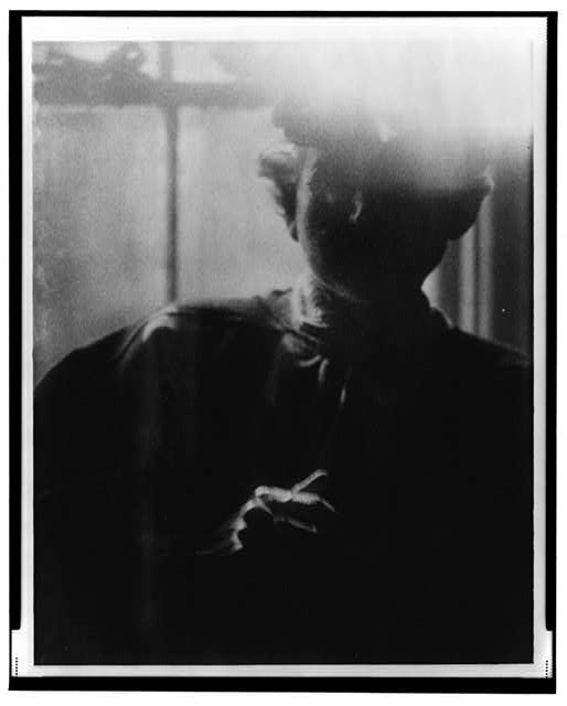 [Portrait of F.H. Day(?) in front of window]
