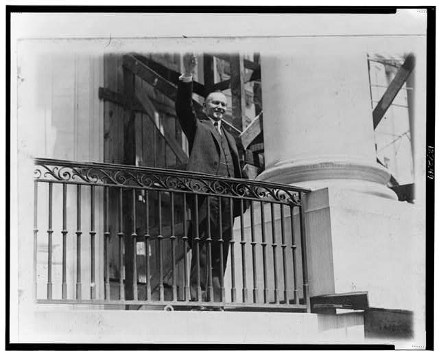President Coolidge waving a greeting to the throngs of children gathered in the White House grounds to roll Easter eggs