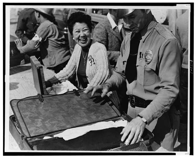 Arcadia, Calif. April 1942--All baggage is inspected before newcomers enter the Santa Anita Park assembly center for evacuees of Japanese ancestry
