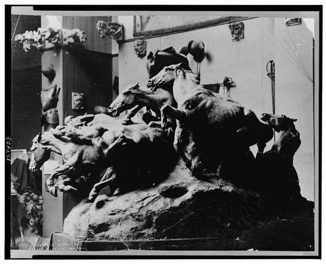 [Sculpture, by Gutzon Borglum, of a group of horses]