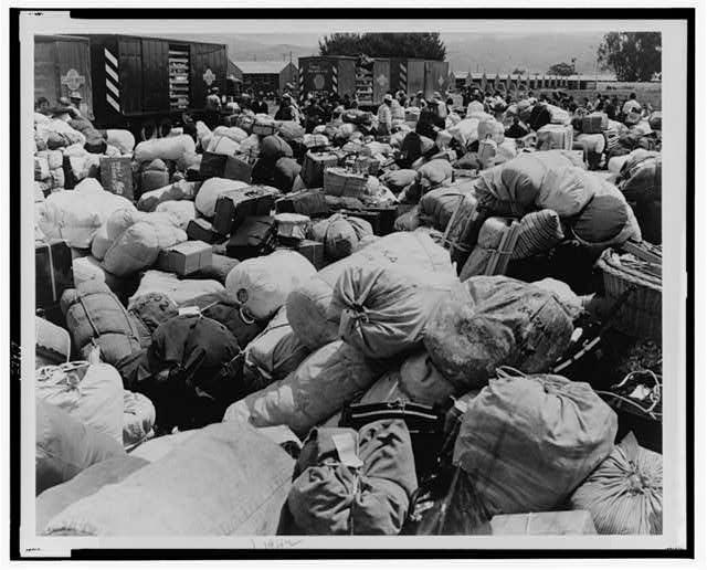 Baggage belonging to evacuees of Japanese ancestry at an assembly center in Salinas,Calif., prior to transfer to a War Relocation Authority center