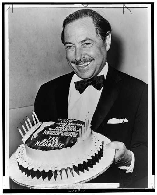 "Tennessee Williams with ""birthday"" cake for the 20th anniversary of ""The Glass Menagerie"" opening"