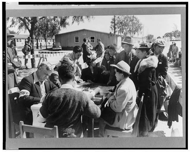 Santa Anita reception center, Los Angeles, California. The evacuation of Japanese and Japanese-Americans from West Coast areas under U.S. Army war emergency order. Registering Japanese-Americans