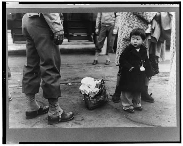 Los Angeles, California. The evacuation of Japanese-Americans from West Coast areas under U.S. Army war emergency order. Japanese-American child who is being evacuated with his parents to Owens Valley