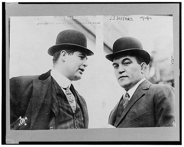 [James J. Jeffries, head-and-shoulders portrait, facing left, shown listening to Sam Berger at left]