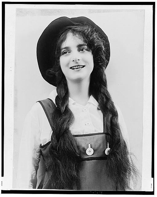 [Dorothy Bernard, half-length portrait, in costume of jumper, hat, and braids]