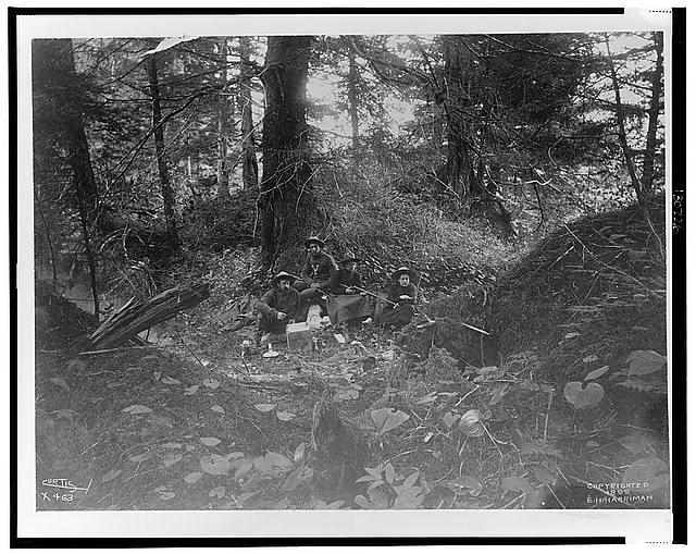 [Two men and two women seated in forest in Alaska, 1899]