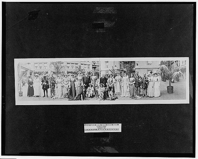 [Unidentified group in costume with John Barrett, Director General of the Pan American Union]
